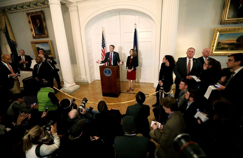 Virginia Gov. Ralph Northam, with his wife, Pam, at his side, speaks at a news conference in Richmond, Va., on Feb. 2.  [Steve Earley/The Virginian-Pilot via AP]