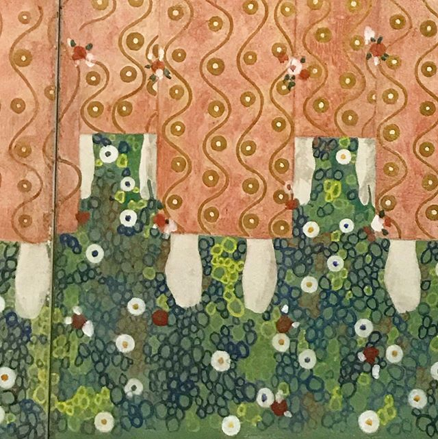 """A replica of panel 11 from Gustav Klimt's Beethoven Frieze (1901-1902) in the #KlimtxRodin exhibition @legionofhonor. Side by Side: """"A Choir of Angels from Paradise"""" and """"This Kiss for the Entire World."""" We all can feel the emotional intensity of Klimt's figures. But the way he beams that intensity to the world comes, to an always surprising degree in person, through design: the flatness of the flowered ground and the evocative apertures of the red and white circle-triangle motifs. Swaying gilded lines in the angels' gowns and above the couple's shoulders give the impression that feelings are literally steaming out of them. We can't help but effuse these golden vapors, the figures seem to confess, regardless of how well-defined our contours seem. The original president of the Vienna Secession movement, Klimt learned to follow his own creative compass and to ignore criticism. A quote from the philosopher and poet Friedrich Schiller painted above another signal work in the exhibition, Nudas Veritas (1899): """"If you can't please everyone with your deeds and your art, please only a few. To please many is bad."""" More thoughts on Klimt and the Vienna Secession here: https://www.artsy.net/article/artsy-editorial-art-nouveau"""
