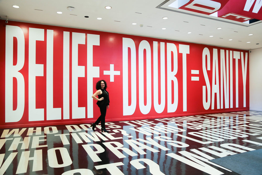 In front of Barbara Kruger at the Hirshorn Museum in DC. Photo by Fluffy Pop Postcards.