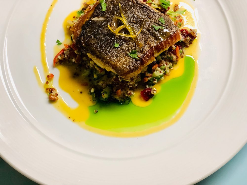 Pan-roasted sablefish with Meyer lemon dressing, accompanied by quinoa and couscous prepared tabbouleh style with cucumber, pine nuts and dried fruits.  Photo credit: Roger Burleigh