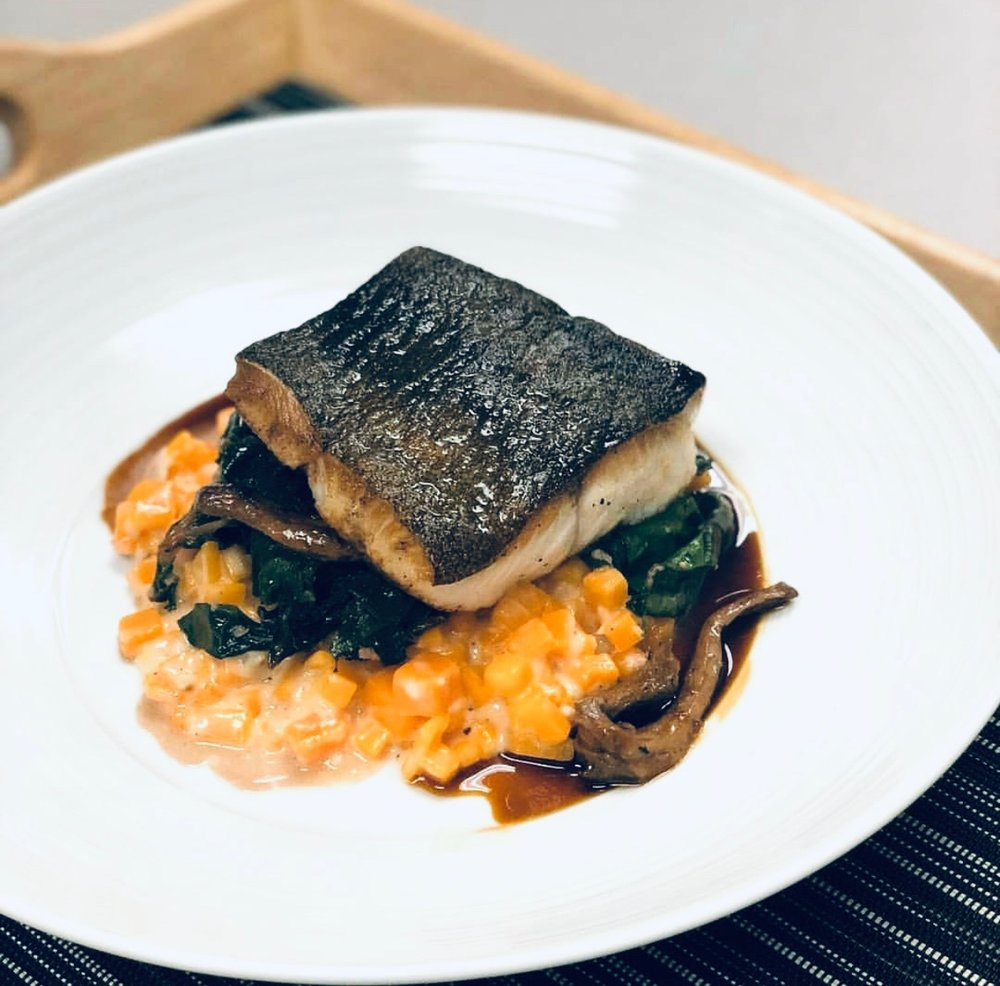 Sablefish with butternut squash risotto, Swiss chard, wild-foraged Big Sur chanterelles and thyme jus.