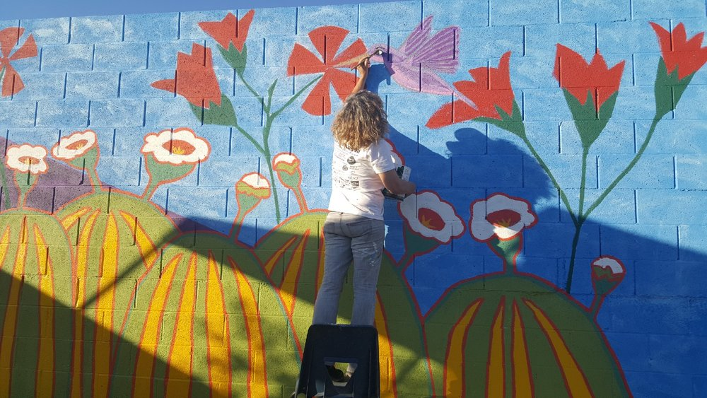 Marcela painting bird.JPG