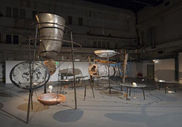 Tunga, Eu, Você e a Lua  (Me, You and the Moon), 2014  Iron, steel, petrified wood, bronze, plaster, terracotta, parabolic mirrors, quartz crystal;  installation: 3.2 x 5 x 7 meters  Courtesy: Galeria Millan, Sao Paulo