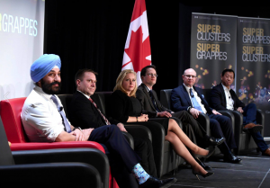 Minister of Sciende, Innovation and Economic Affairs Navdeep Bain meets with busineee leaders to announce funding for Supercluster.