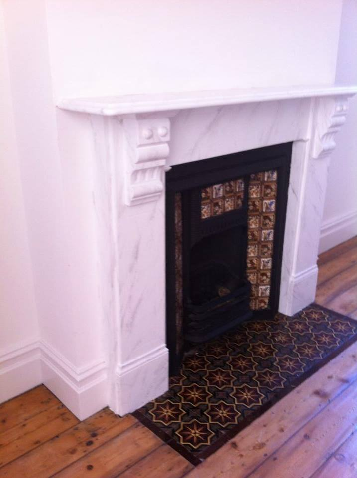 faux white carrara marble painted fireplace