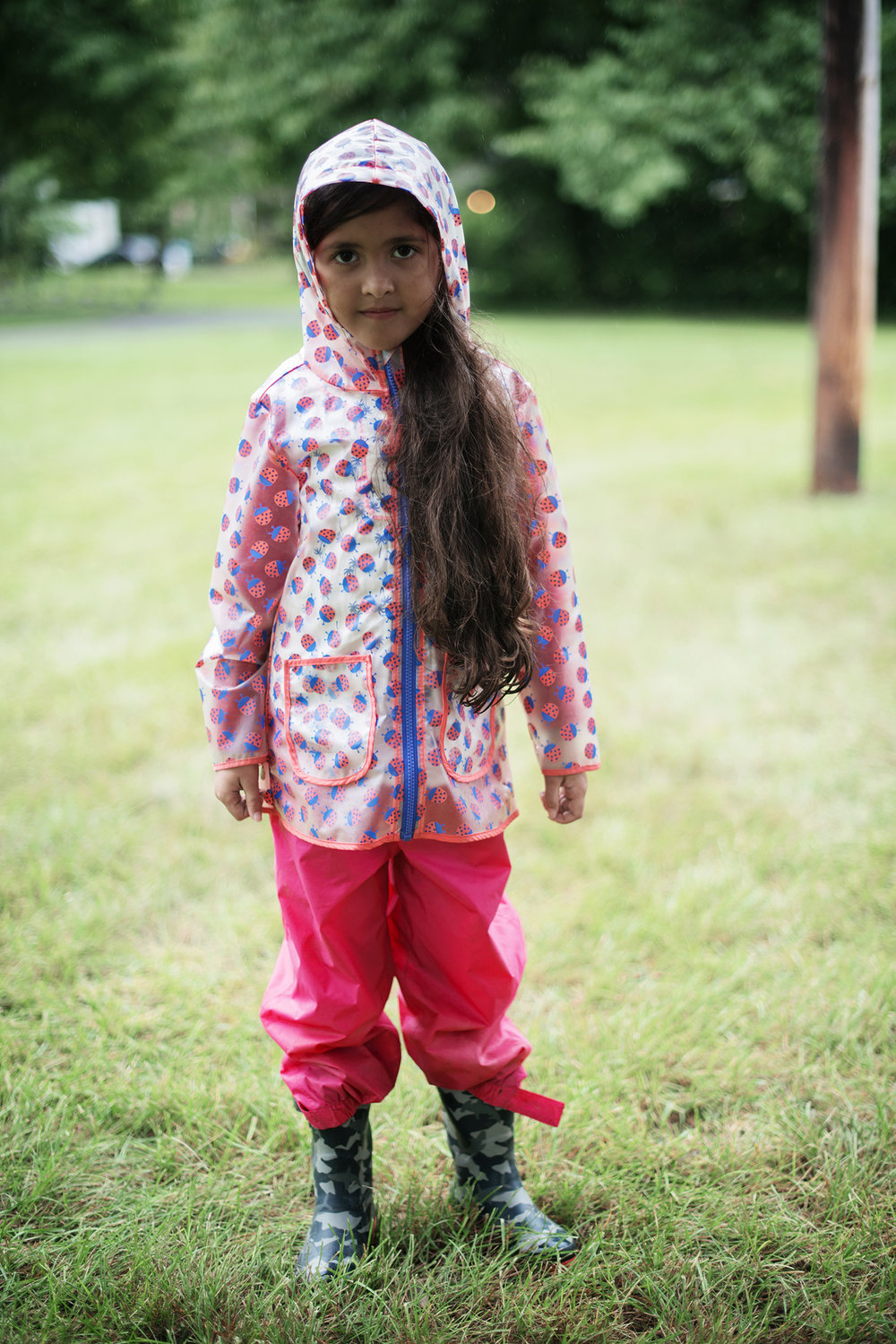 child in raincoat and rain boots.jpg
