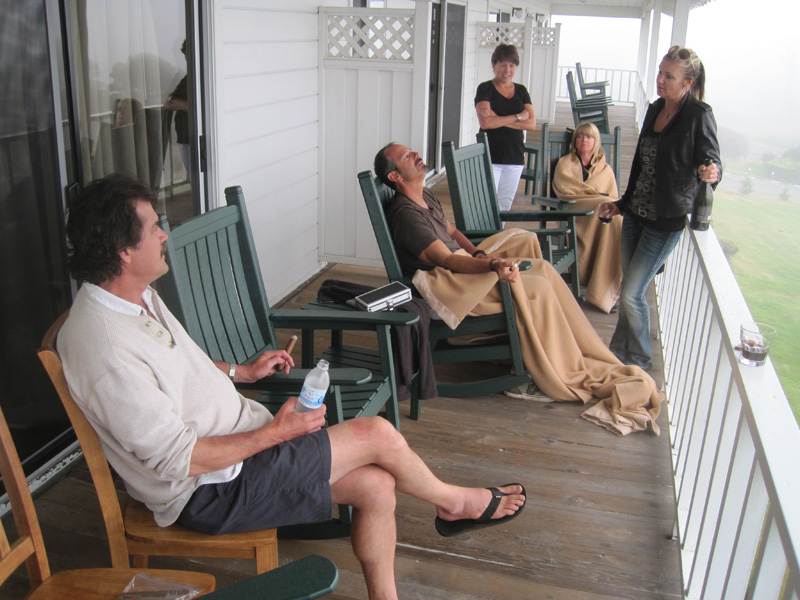 Relaxing with pre-dinner cigars and wine on a balcony at the Little River Inn overlooking the foggy Pacific Ocean