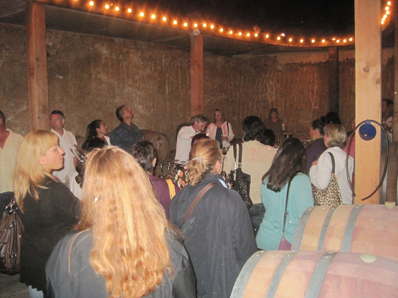 Winemaker Phil Gregory (center in white shrit) in the underground barrel room of Vena Cava at La Ville del Valle