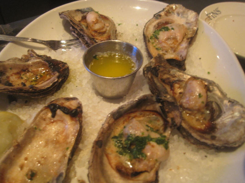 Sizzling smoked oysters at G. W. Fins