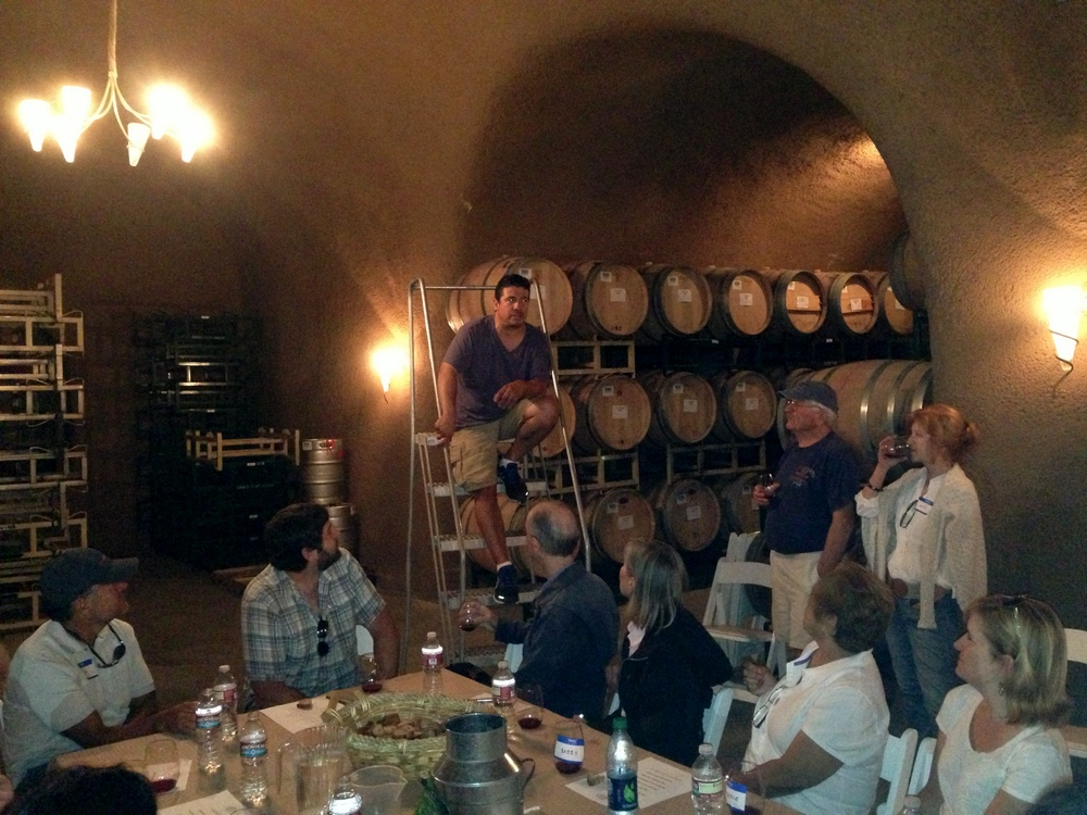 Paris Driggers of Sika Wines hosting a barrel tasting in the caves.
