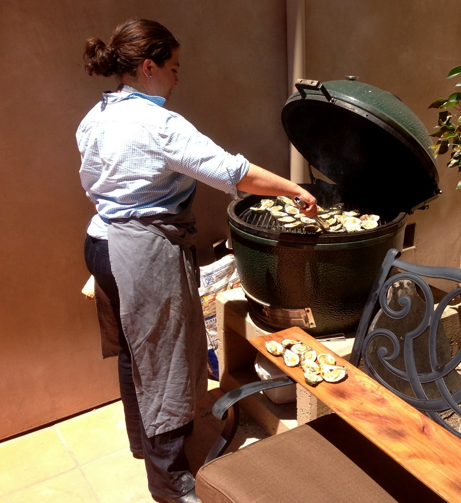 Gia cooking oysters on the half shell at Pete and Cathy Seghesio's house