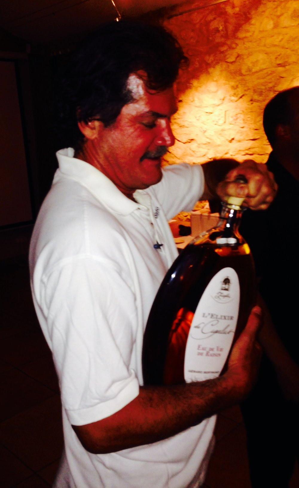 Popping a crystal 3 liter bottle of L'Elixer de Cigalus (86 proof) for a finale nightcap