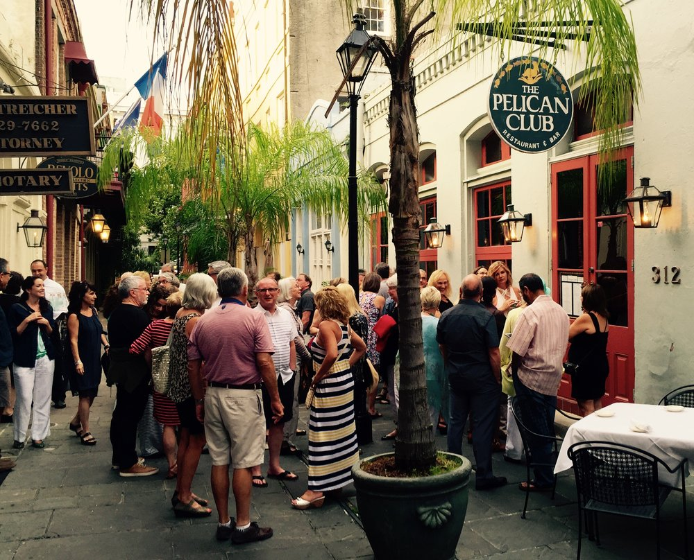 """Gathering outside of Pelican Club for our  pre-finale dinner special surprise """"happy hour"""" in the streets."""