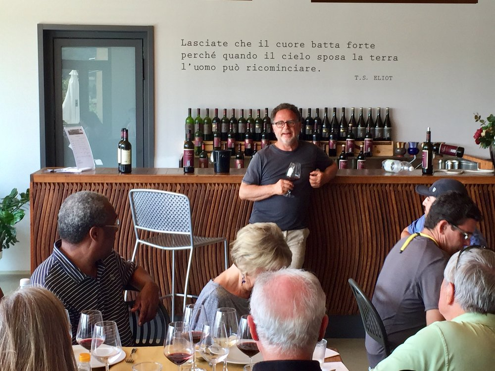 Copy of Michele Satta discussing his wines during our tasting lunch at his winery.