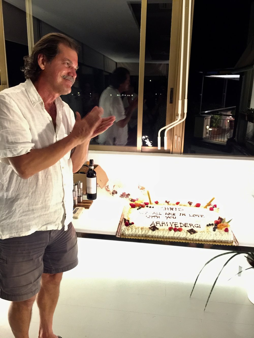 """Copy of On the final night of the final tour we sabered a bottle of champagne  and then the folks at Hotel Paradiso gave us a beautiful """"arrivederci""""  cake complete with fireworks."""