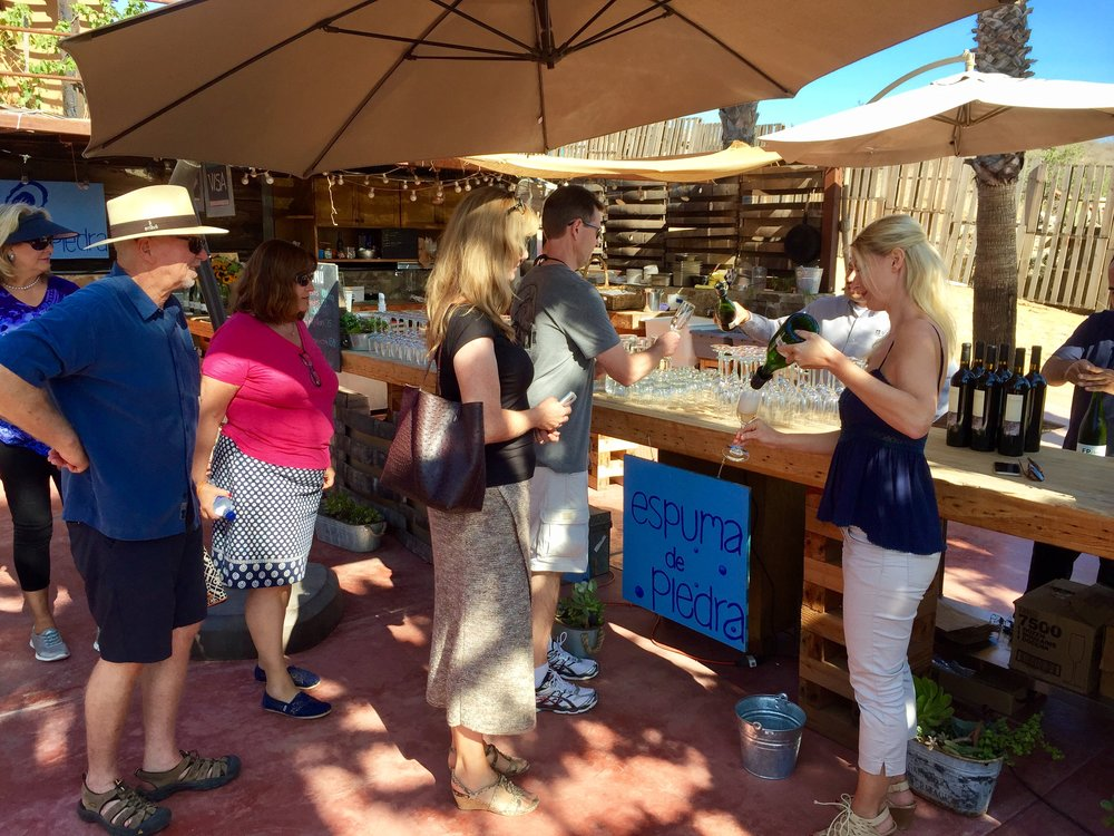 Oysters and champagne for breakfast ... Petra pouring Casa de Piedra bubbly at Conchas de Piedra