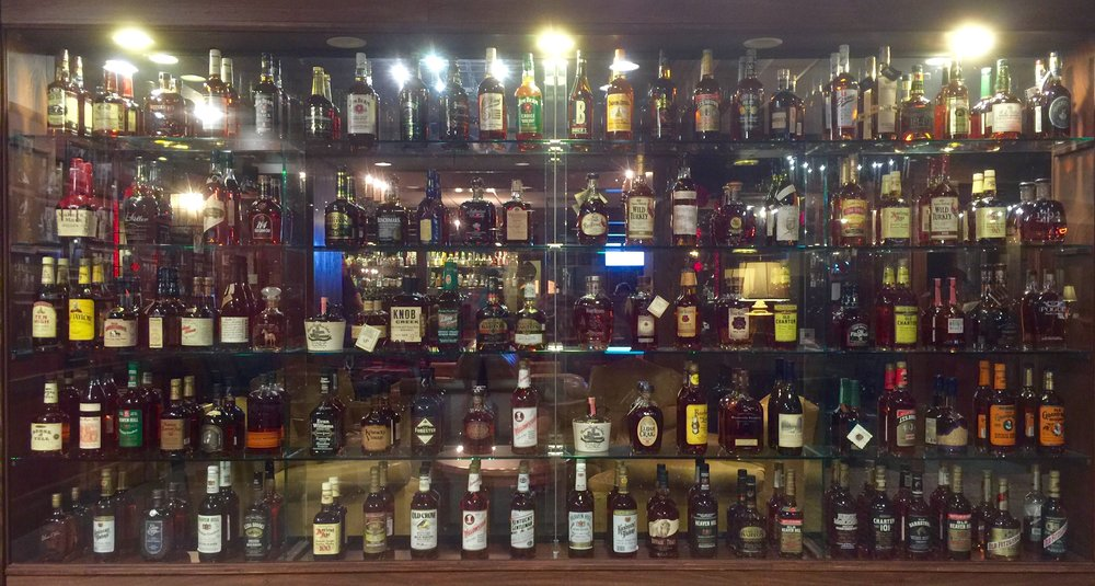 A dizzying collection of Bourbons at Jockey Silks Bar, one of the favorite establishments on the Urban Bourbon Trail.