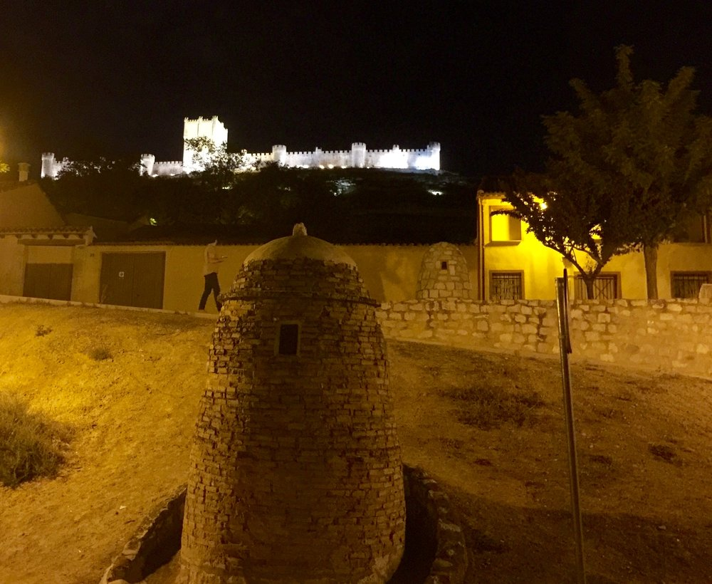 The view from our hotel in Ribera del Duero of Castle Penafiel lit up at  night.