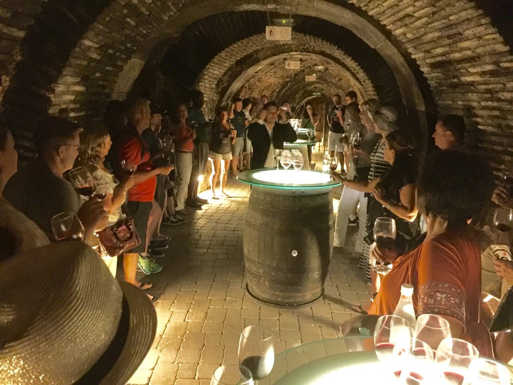 Wine tasting in the private caves of Fabulista in the medieval village of Laguardia in Rioja.  Our animated host Fernando (center) brought the winery's colorful history to life!