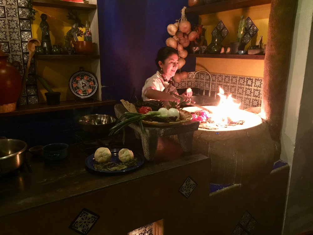 Pioneer Oaxacan chef Celia Florian of Quince Letras giving a mole cooking demo at her restaurant.