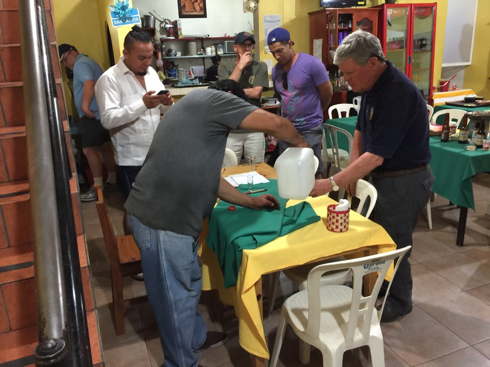 """Drinking the """"good stuff"""" in the kitchen at La Soledad after dinner."""