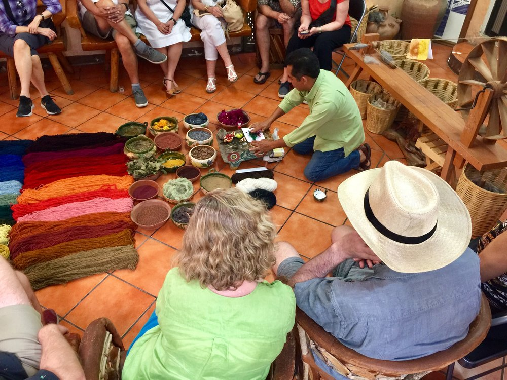 Bulmaro demonstrating timeless techniques for creating dyes from natural ingredients to color the fibers for his rugs.