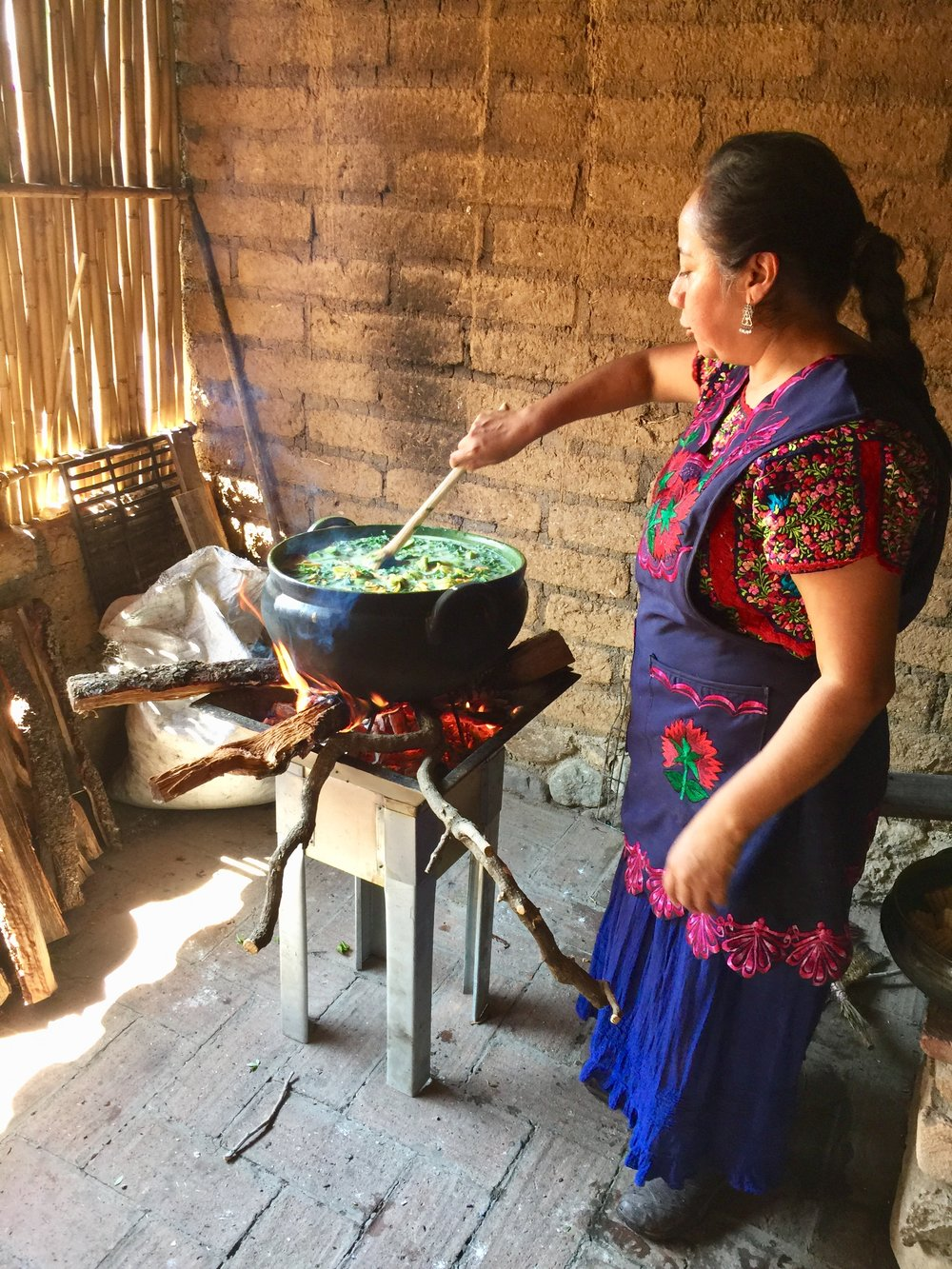 Carina hosting a cooking demo at Tierra Antigua