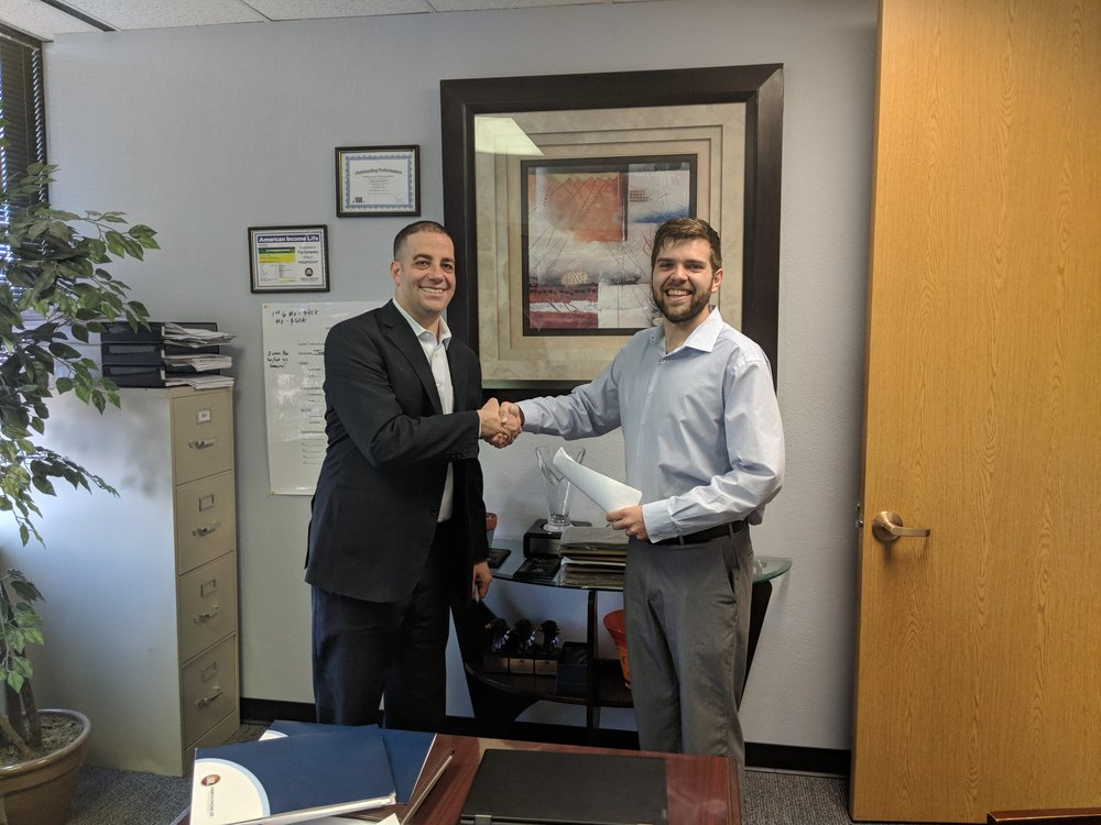 New Supervising Agent Kaleb Fantauzzi signs his first management contract and shakes with his Managing General Agent Josh Goodman!