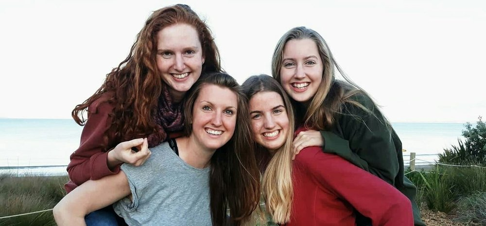 Shyla Kelly (bottom left), founder of Initialize NZ, with her three sisters at Long Bay Beach. Find out more about Shyla    here   .