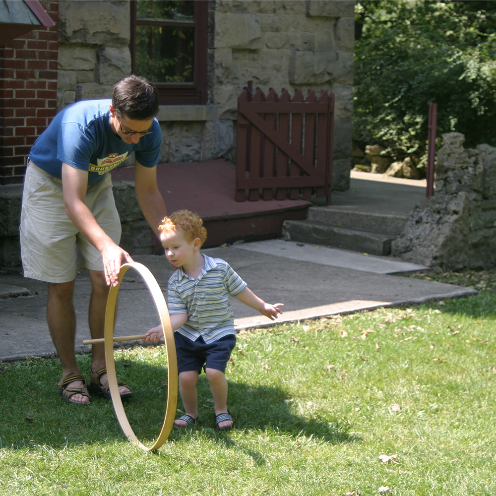 father and son with hoop.jpg
