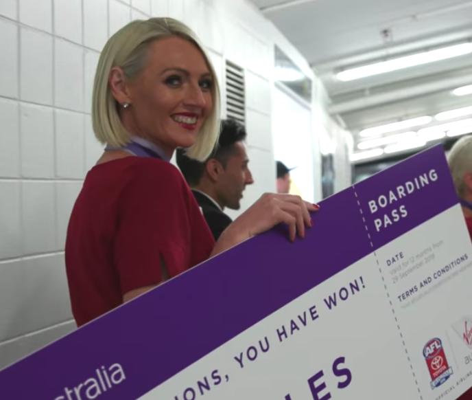 Virgin Australia air hostess ready to award the lucky winners