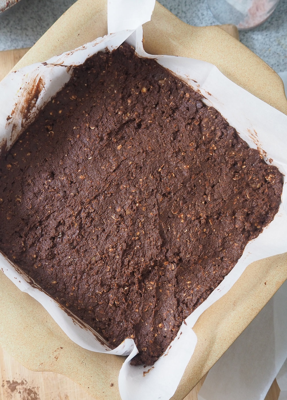 Press the brownie batter into a even layer.