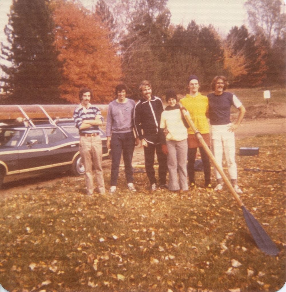 Winning team at the club's first regatta in Lansing, Michigan. Left to right: Mike Weisman (manager), George Lawrence (bow), Bob Henn (2), Marcy Esler (cox), Grant Esler (3), Mark Doman (stroke). October 23, 1976.