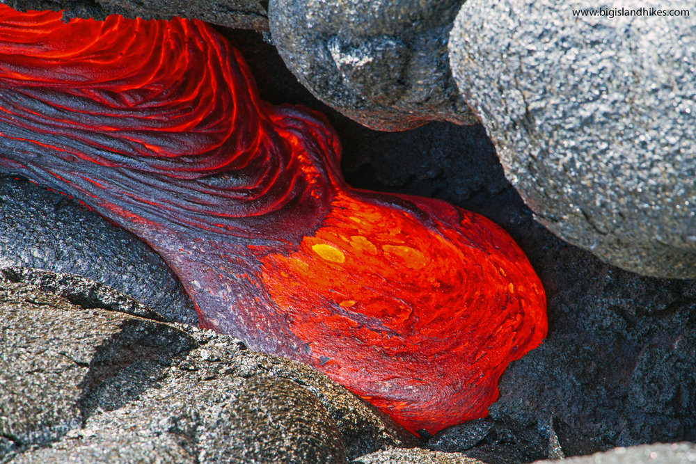 hawaii volcanoes flowing lava.jpg