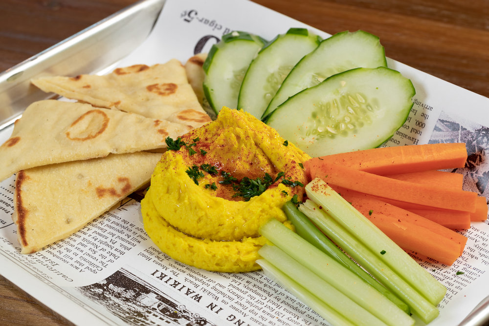 BreadfrUIt hummus - Local breadfruit, tahini, lemon, garlic, turmeric with carrots, celery, cucumber & flatbread - $11