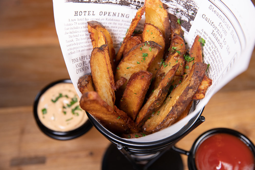 PAPAS BRAVAS - Hand-cut crispy skin potatoes served with a chipotle aioli - $9