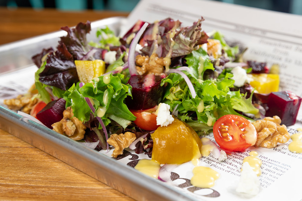 roasted beet salad - Roasted golden and red beets, goat cheese, walnuts, red onions, grape tomatoes, mixed greens, mango vinaigrette - $11Add Grilled Chicken - $4