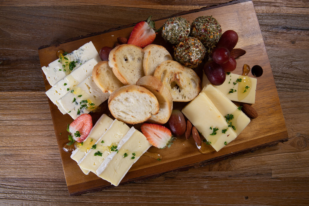 CHEESE PLATTER - Assorted cheese platter with French baguette bread, almonds, strawberries, grapes & yuzu marmalade - $15