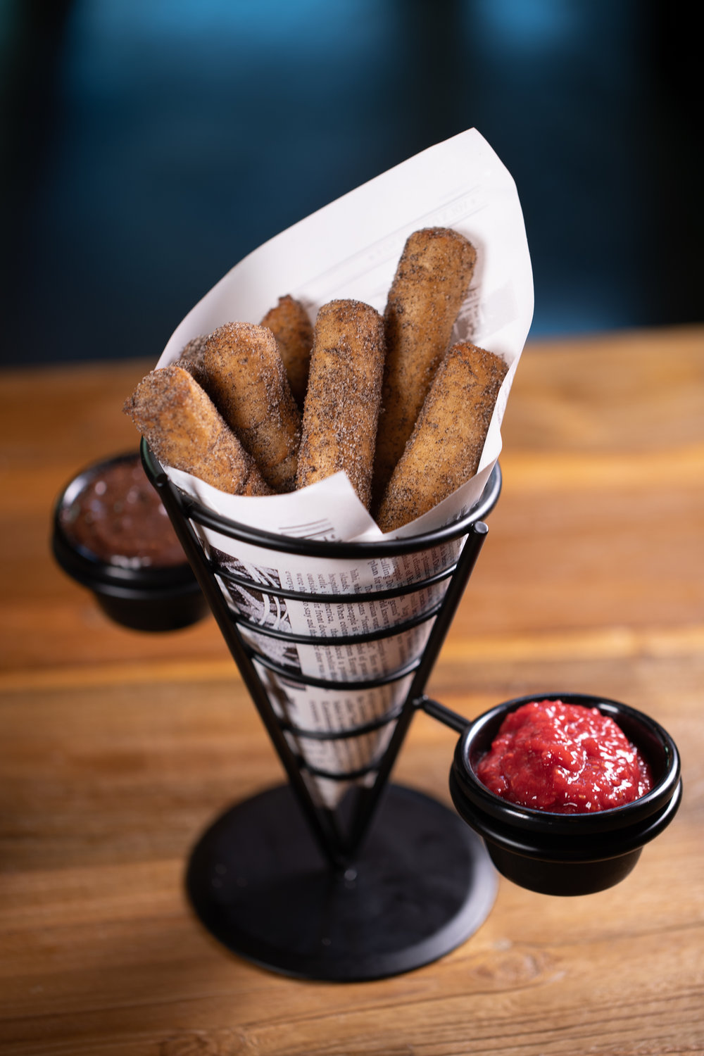 OREO® CRUMBS CHURROS - Cinnamon and Oreo® churros, served with raspberry coulis & hot fudge - $9