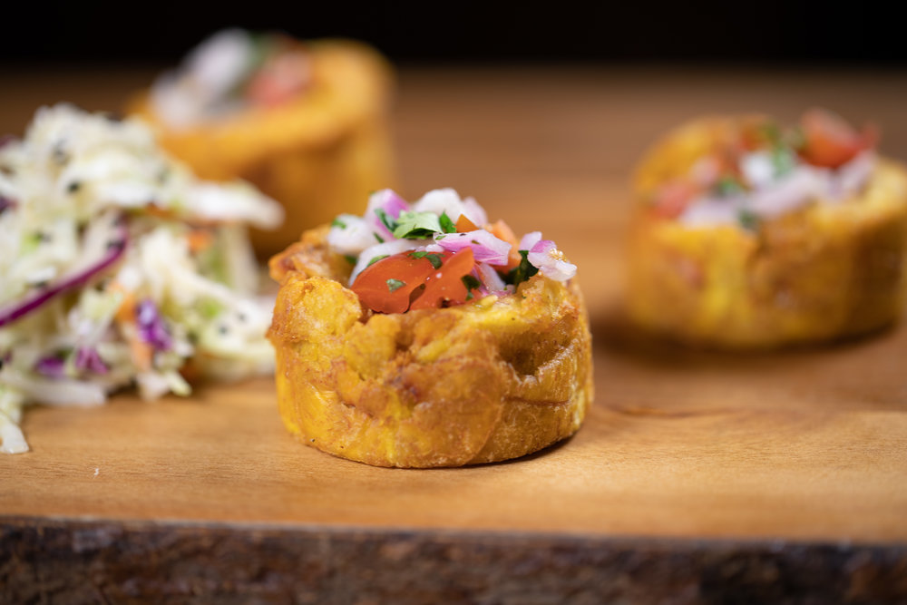 ceviche on tostones - Fresh mahi, cilantro, lime, tomatoes, red onions and avocado served in plantain cups - $15