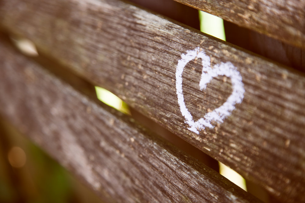 Closeup of a Heart drawn on a wooden bench
