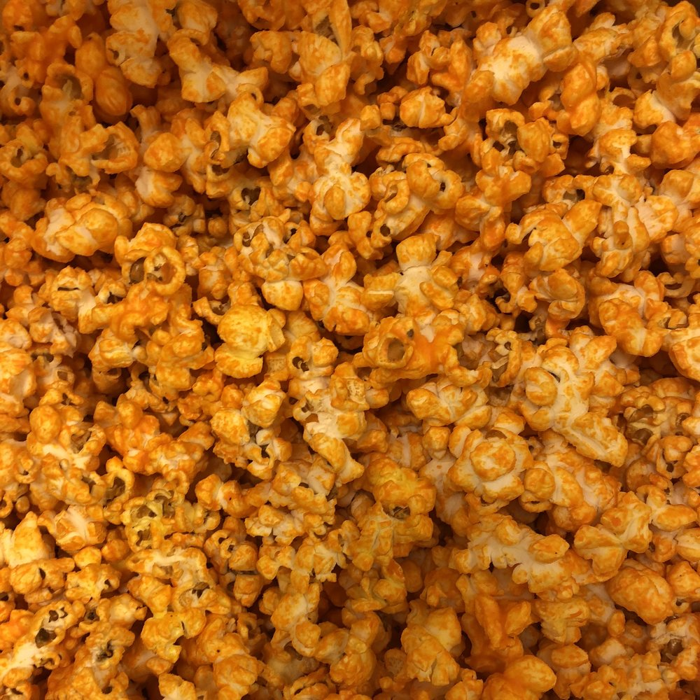 Cheddar Popcorn - The cheesiest popcorn around!Cheddar Cheese, White Cheddar Cheese, Chicago Style, Tex-Mex, Texas Trio, Beer Cheddar, Cheesy Garlic Bread, Jalapeño Ghost Cheddar