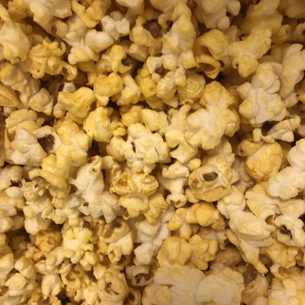 Seasoned Popcorn - Delicious seasonings are added to our popcorn to add a special pizzaz!Bacon and Cheese, Buffalo, Cajun, Dill Pickle, Jalapeño, Nacho Cheese, Parmesan Garlic, Pizza, Ranch, Salt and Vinegar, Sea Salt and Pepper, Sour Cream and Chive