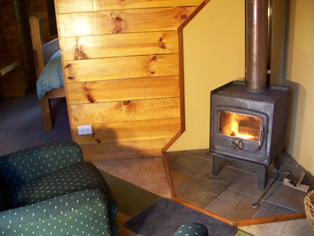 What could be more romantic than relaxing in front of the wood fire in your own private cosy Cradle Mountain Tas cabin accommodation with log fire?