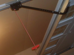 Home inspector explains operation of emergency garage door release