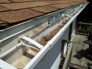Home inspection photo shows loose gutters on home