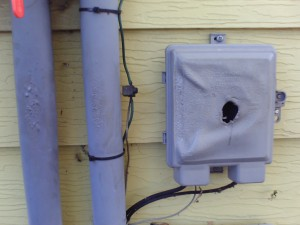 Home Inspector discovers melted exterior cable, electrical box