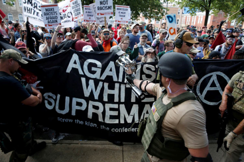 4Members of white nationalists are met by a group of counter-protesters in Charlottesville, Virginia, Aug. 12, 2017. Joshua Roberts / Reuters