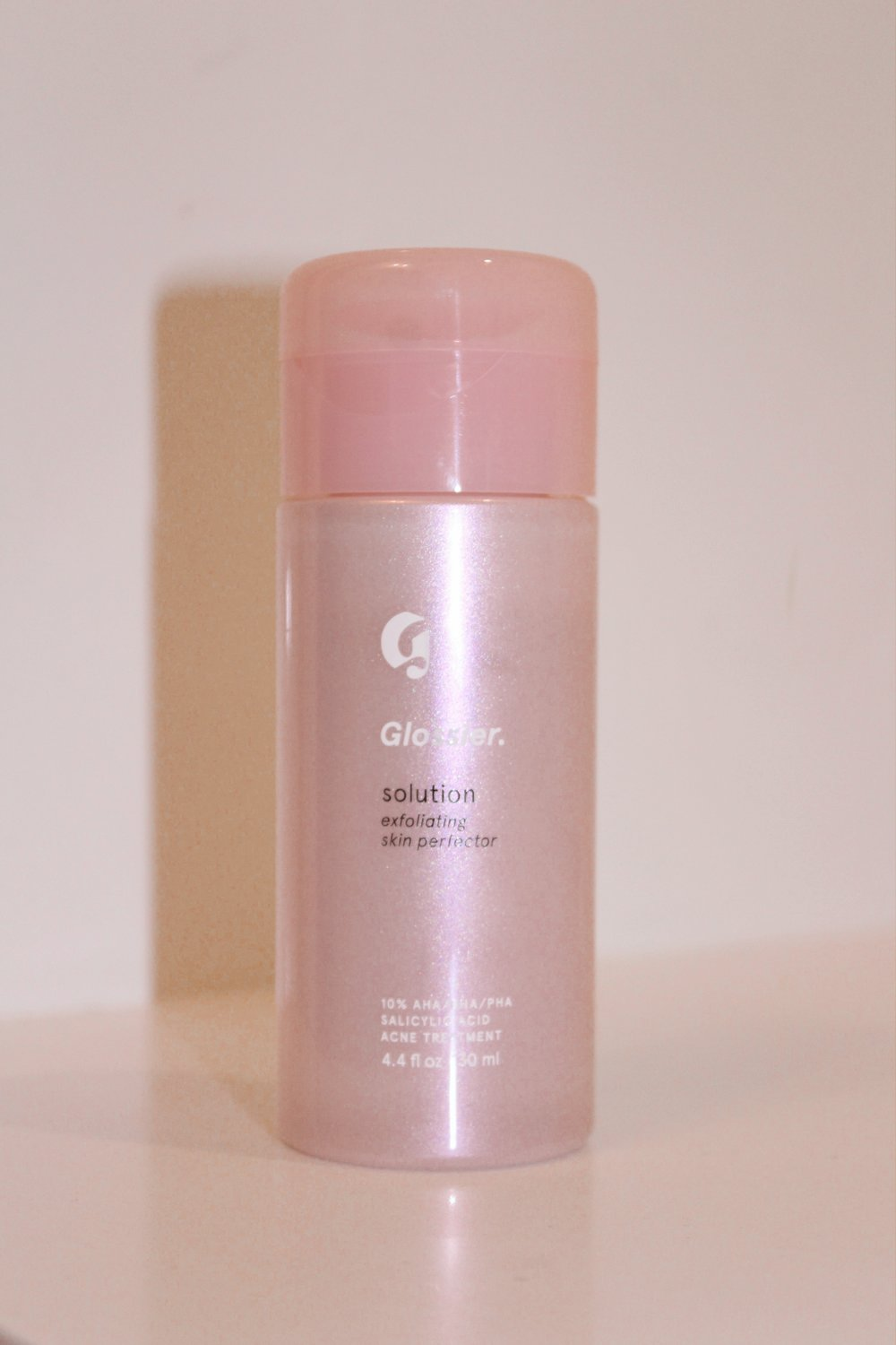 glossier solution - The Glossier Solution is a chemical exfoliator that helps purify and clear skin in 4 weeks. I have been using this for a few months and so far I'm loving it! It has helped reduce redness and blemishes for me, as well as clogged pores. I use this every night and it is amazing.