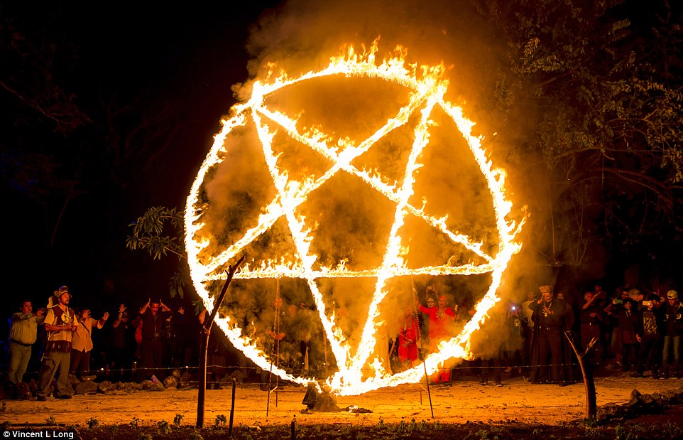 26767C9200000578-2986101-Worship_Participants_dance_before_giant_burning_pentagrams_befor-a-8_1426083209295.jpg